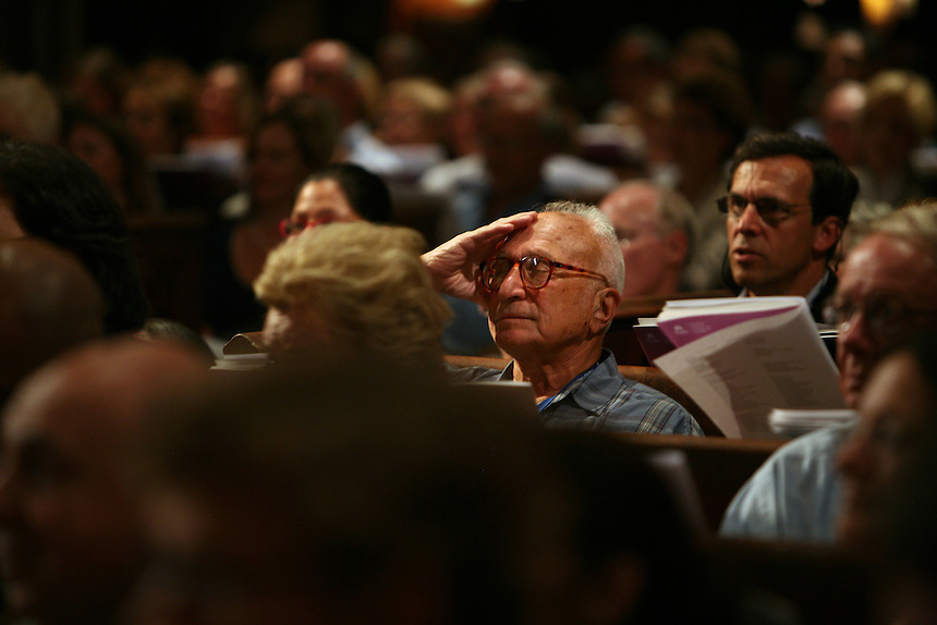 A man in the audience closes his eyes as he listens to the choirs sing Amazing Grace during Remember to Love: Let Us Love One Another With A Sincere Heart, an observation of the 10th Anniversary of September 11 at Trinity Church in Manhattan, NY on September 09, 2011. The six choirs performing include NYC Master Chorale, Trinity Choir, Young People's Chorus of New York City, The Washington Chorus, The Bach Choir of Bethlehem and The Copley Singers.