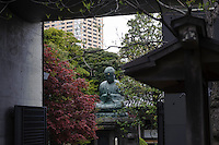 """A Buddha statue, Yanaka, Tokyo, Japan, April 20, 2012. Yanaka is part of Tokyo's """"shitamachi"""" historic working class wards. Recently it has become popular with Japanese and foreign tourists for its many temples, shops, restaurants and relaxed atmosphere."""