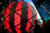 A man kisses the New Year's Eve Ball as it is tested for celebrations on New Year Eve 2012 in New York City. 12/30/11.  Photo by Eduardo Munoz Alvarez / VIEWpress.