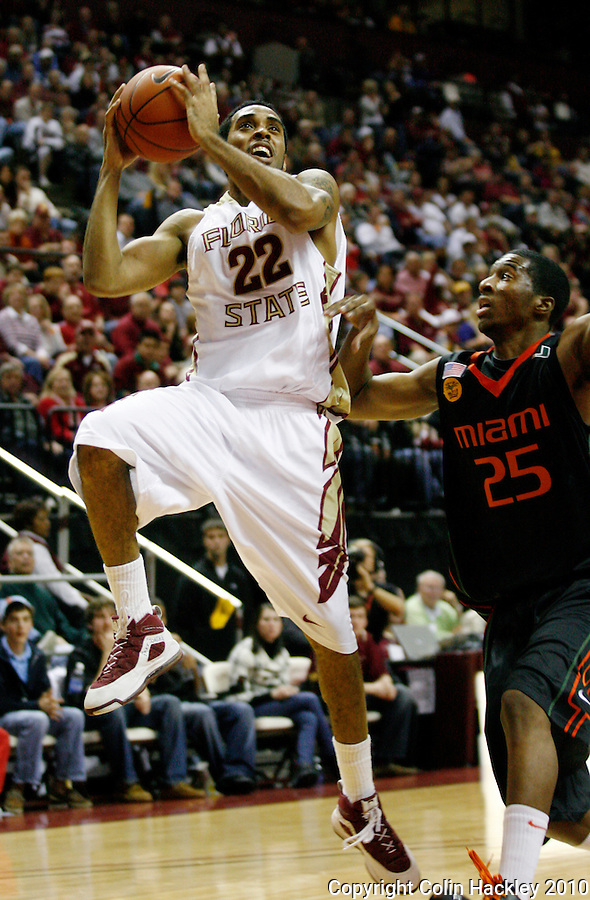 TALLAHASSEE, FL 2/6/10-FSU-MIAMI BB10 CH20-Florida State's Derwin Kitchen gets by Miami's Garrius Adams for a shot during second half action Saturday at the Donald L. Tucker Center in Tallahassee. The Seminoles beat the Hurricanes 71-65...COLIN HACKLEY PHOTO