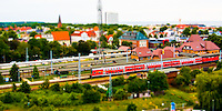 Train on rail line connecting Warnemunde, Germany with Rostock and Berlin. Tilt/Shift effect with focus on train.