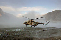 Helicopter landing on heliport in valleys of Karokoram Mountains, Skardu Valley, North Pakistan