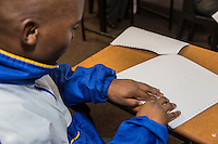 South Africa, Cape Town.  Blind Student Reading Braille.  Athlone School for the Blind.