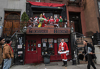 NEW YORK, NY - December 10: Revelers dressed as Santa Claus dance in a bar during the annual SantaCon event in New York City , December 10, 2016.VIEWpress/Maite H. Mateo