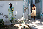 Staff members stand in the courtyard of the St. Francois De Sales hospital in Port-au-Prince, Haiti. The hospital's main building collapsed in the recent earthquake, forcing patients to be treated outside.