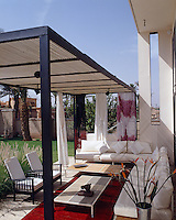The terrace with its shade-giving canopy and comfortable sofas is a perfect spot to relax