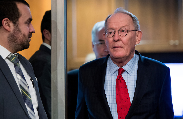 UNITED STATES - JANUARY 18: Chairman Sen. Lamar Alexander, R-Tenn., followed by Secretary of Health and Human Services nominee Rep. Tom Price, R-Ga., arrive for Price's confirmation hearing in the Senate Health, Education, Labor and Pensions Committee on Wednesday, Jan. 18, 2017. (Photo By Bill Clark/CQ Roll Call)
