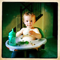 Ventura, California, May 3, 2011 - Finn Maddox Peveto with his new favorite food: peas.