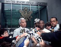 IN ADVANCE FOR 20TH ANNIVERSARY OF CROWN HEIGHTS RIOTS IN BROOKLYN, NY ON AUGUST 19, 1991. Lemrick Nelson (C, in white) with his lawyers Treavor Headley (L) and Michael Warren (R) outside Brooklyn Federal court in September 1995 during his trial for the murder of Yankel Rosenbaum in the 1991 Crown Heights riots. A Federal judge has overturned the convictions of both Nelson and Charles Price in Rosenbaum's murder. (© Richard B. Levine)
