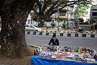 A young book seller on a pavement in Bangalore, India.