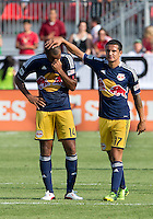July 20, 2013: New York Red Bulls midfielder Tim Cahill #17 comforts New York Red Bulls forward Thierry Henry #14 at the end of a game between Toronto FC and the New York Red Bulls at BMO Field in Toronto, Ontario Canada.<br /> The game ended in a 0-0 draw.