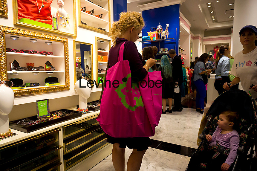 """Grand opening of  the C. Wonder store in the Time Warner Center in New York on Saturday, September 22, 2012. The store, the company's second, was created by venture capitalist Christopher Burch, former husband of the designer Tory Burch and sells """"preppy"""" style merchandise. Ms. Burch has complained that the designs in the store are similar to hers, selling at about one third the price, and has threatened legal action. (© Richard B. Levine)"""