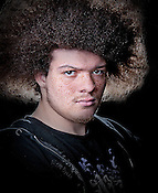 Studio Portrait, color portrait of young man with big hair