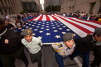 Members of the Milby High School JROTC carry the American Flag during the 2015 Veteran's Day Parade in downtown Houston.