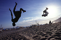 Children jump, play, give somersault and have fun at Ipanema beach, Rio de Janeiro, Brazil.