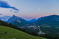Gibbous Moon over Banff townsite, Banff National Park, Alberta, Canada. Taken July 29, 2012 with Canon 7D and 10-22mm lens at ISO 100, f/6.3 and metered. Taken in twilight. Peak is left is Mt. Rundle. Taken from Mt. Norquay viewpoint overlooking town looking south.