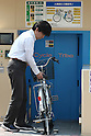 Apr. 30, 2010 - Tokyo, Japan - A man enters his bicycle into the elevator of an automated underground parking in Tokyo, Japan on April 30, 2010. The Sugiyama Park Subway Bicycle Parking opened on April 20 and can store up to 250 bicycles. It costs 2,500 yen for a monthly ticket to use. Starting May 1, users who will park their bicycles in illegal spaces near Shin Nakano station will be ticketed.