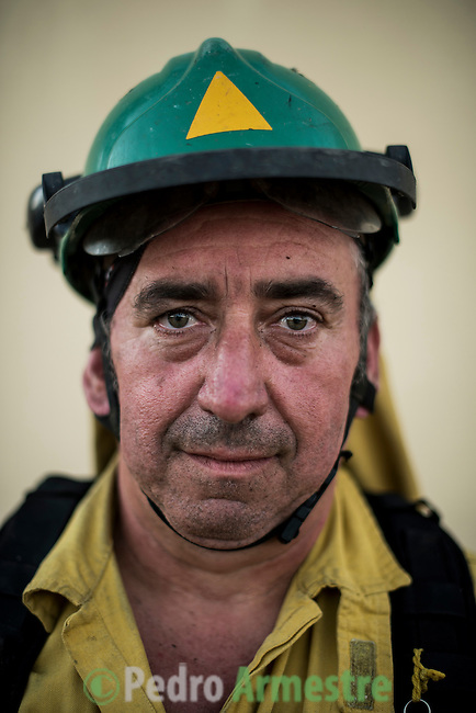 Jose Antonio Sánchez Baeza (Martillo)  of Carratraca, Málaga. The firefighter from the BRICA Málaga 703, the Andalusian Service firefighting (INFOCA),  posses after a wildfire in Los Barrios near Cadiz on July 25, 2015. © Pedro ARMESTRE