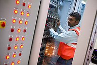 An employee is seen working on ALSTOM's Relay Rack in the Signalling Equipment Room (SER) at the depot and primary station, Baiyappanahalli, in Bangalore, Karnataka, India on 10th March 2011..Photo by Suzanne Lee/Abaca Press