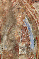 Detail of Christ in Majesty shown within a mandorla, 12th century frescoes in the choir of the Pre-Romanesque Chapel of Saint Martin de Fenollar (Sant Marti de Fenollar), 9th century, Maureillas Les Illas, Pyrenees Orientales, France. The frescoes are an outstanding piece of work, which greatly impressed modern artists, especially Pablo Picasso and Georges Braque in 1910. Picture by Manuel Cohen