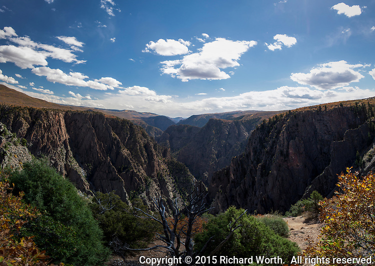 The view from the Tomchi View pullout along the South Rim Drive at Black Canyon of the Gunnison National Park in southwestern Colorado.  Mulitiple images have been  blended to provide a wide perspective.