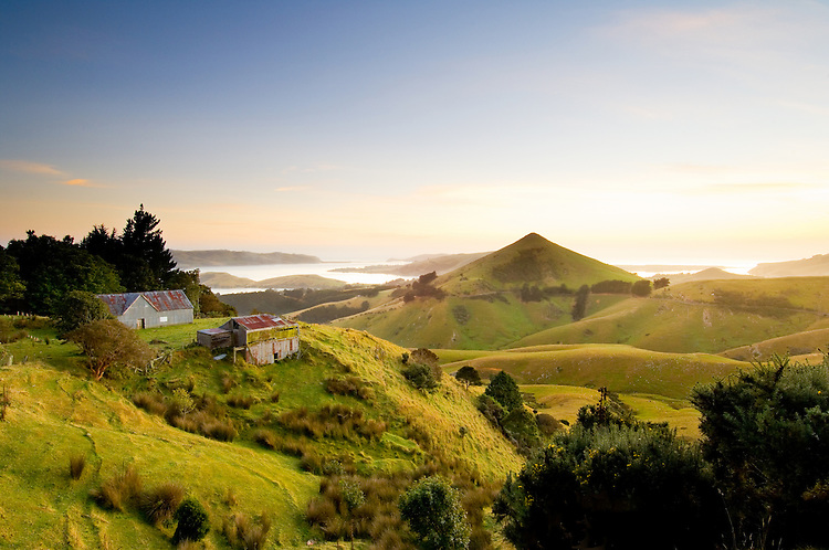 Shearing shed, Harbour Cone and the Otago Peninsula towards Tairoa Head at sunrise, Otago, South Island, New Zealand - stock photo, canvas, fine art print