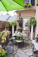 Small patio garden with house, shade, umbrella, garden furniture, pot containers, ornaments