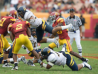 California defenders' Mychal Kendricks and Aaron Tipoti tackle C.J. Gable of USC during the game at LA Memorial Coliseum in Los Angeles, California.  USC defeated California, 48-14.