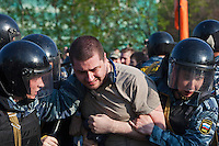 Moscow, Russia, 06/05/2012..Police arrest protestors at opposition demonstration against Russian Presidential election results on the eve of Vladimir Putins inauguration as President.