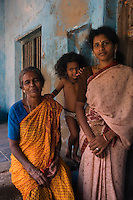 Family at Nagapattinam, Tamil Nadu...Family at 4 Sattayappar Kovil Mada Vilagam, Nagapattinam..Old Lady Yellow Sari. Jeyam..Mother of children: Amuda Singaravel..Small Girl: Deepika.