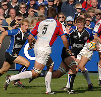 20,05/06 Powergen Cup Bath Rugby vs Bristol Rugby, Andy Beattie running with the ball puts a hand up to hold of Ollie Hodge. Bath, ENGLAND, 01.10.2005   © Peter Spurrier/Intersport Images - email images@intersport-images..