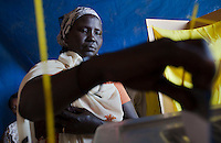 A woman casts her vote at a polling station in Malakal, South Sudan. On 9th January 2011 Southern Sudan's people voted in a referendum on whether to become independent from the North..