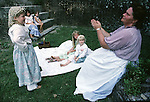"""Billie Rachel, right, plays a civil war era game called, """"Buy a Button, Steal a Button', with (l to r) Mandy Burdine, Samatha Holmes, Evelyn Rachell and Ana Burdine after Civil War re-enactment for the the Battle of Fort Morgan, Mobile, Al in 2001. Jim Bryant Photo. @2001. All Rights Reserved."""