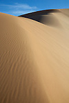 Sahara desert sand dunes with blue sky at Erg Chebbi, Merzouga, Morocco.