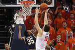 02 January 2016: Notre Dame's Bonzie Colson (35) and Virginia's Mike Tobey (10) challenge for a rebound. The University of Virginia Cavaliers hosted the University of Notre Dame Fighting Irish at the John Paul Jones Arena in Charlottesville, Virginia in a 2015-16 NCAA Division I Men's Basketball game. Virginia won the game 77-66.