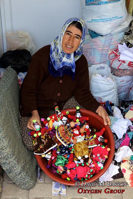 Woman Selling Dolls