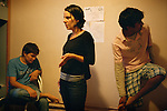[English]  At the hotel with the minors taken in charge in the emergency accommodation system. Leila is a social worker for France Terre d'Asile. In November 2007, she has been taken into custody for more than 12 hours because she had migrant's phone numbers saved in her cell-phone.<br /> <br /> [Francais]  A l'hotel avec les jeunes pris en charge dans le dispositif d'hebergement d'urgence. Leila est animatrice sociale chez France Terre d'Asile. Le 19 novembre 2007, elle a ete interpellee a son domicile au petit matin, perquisitionnee et maintenue en garde a vue pendant plus de 12h pour avoir donne son num&eacute;ro de telephone portable a un migrant afghan.