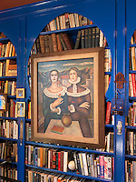 A detail of the Moroccan-inspired bookshelves in the library, painted a vibrant ultramarine blue