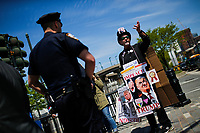 NEW YORK, NY - May 04:  Activists speak with NYPD officers in front of the Intrepid Sea, Air and Space Museum before President Donald Trump arrive to city on May 04, 2017. in New York. U.S. president Trump will meet Australian Prime Minister Malcolm Turnbull on the 75th anniversary of the Battle of the Coral Sea by US and Australian forces against the Japanese In New York City. Photo by VIEWpress/Eduardo MunozAlvarez