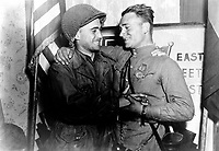 Happy 2nd Lt. William Robertson and Lt. Alexander Sylvashko, Russian Army, shown in front of sign (East Meets West) symbolizing the historic meeting of the Russian and American Armies, near Torgau, Germany. April 25, 1945. Pfc. William E. Poulson. (Army)<br /> NARA FILE #:  111-SC-205228<br /> WAR &amp; CONFLICT #:  1096