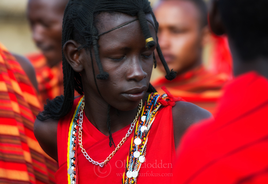 Masai warriors prepare for dance.
