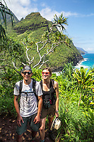 Two hikers on the Kalalau Trail near Hanakapi'ai Beach, Kaua'i.