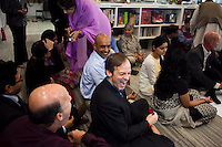 Staff and guests share a light moment during the puja (prayer and blessing) at the opening ceremony of the new Bill &amp; Melinda Gates Foundation office in New Delhi, India on 17th December 2010. Photo by Suzanne Lee for Gates Foundation