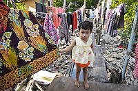 A little girl who lives in the slums at Rashada Pier.