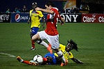Ecuador's player Juan Paredes ( Down) fights for the ball against Chile's player Eugenio Mena during their friendly match at the Citi-Field Stadium in New York, August 15, 2012. Photo by Eduardo Munoz Alvarez / VIEW.