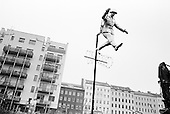 Berlin, Germany<br /> November 8, 2009<br /> <br /> At the place where an East German soldier jumped the wall into West Berlin that separated the city a statue is placed in his honor. The image is a famous photograph of the crossing..<br /> <br /> On November 9, 2009 the world and Germany will celebrate the fall of the wall on November 9, 1989.