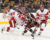 Garrett Noonan (BU - 13), Ahti Oksanen (BU - 2), Johnny Gaudreau (BC - 13), Robbie Baillargeon (BU - 19) - The Boston College Eagles defeated the Boston University Terriers 3-1 (EN) in their opening round game of the 2014 Beanpot on Monday, February 3, 2014, at TD Garden in Boston, Massachusetts.