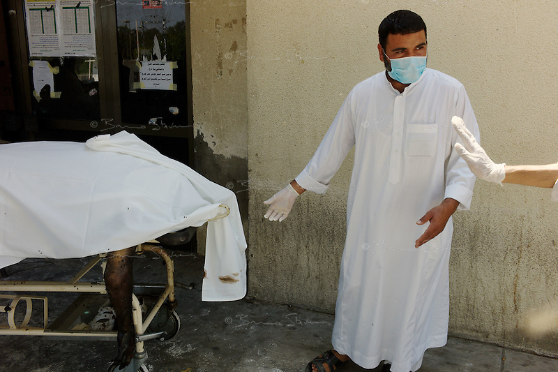 Tripoli, Libya, August 27, 2011.More than 100 bodies have been recovered in Abu Salim Hospital before being transfered to a functionning morgue in another Tripoli hospital. Details of what happened are unclear, but it seems some were wounded Khaddafi soldiers and were executed on their hospital beds..