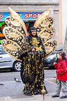 Spain, Barcelona. La Rambla is a street in central Barcelona. Street performance artist.