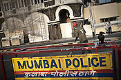 Mumbai Police barricades are seen while a sweeper is seen cleaning up the streets outside the Taj Mahal Hotel, one of the sites of the 2008 terrorist attacks, in Mumbai, India. Photograph: Sanjit Das